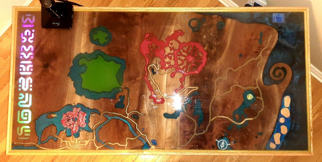 Custom build epoxy and wood PC table with design featuring overhead map from Zelda Breath of the Wild video game